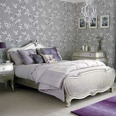 Glam lilac and silver bedroom with silver painted bed, chest and nightstand, chandelier and wallpaper.... by deanna