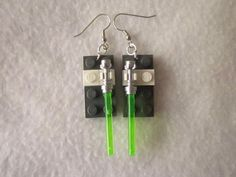 Lego earrings are easy to quickly customize for a unique look.  We added a pair of Lego light sabers to these and changed the look almost immediately.  Read more at: http://adobebrick.xyz/2016/06/14/lego-earrings/