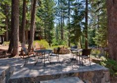Tahoe City Vacation Rental - VRBO 566719 - 6 BR Lake Tahoe North Shore CA House in CA, Gorgeous, Upscale Home with Hot Tub - stone patio - cant tell if yard is level beyond that.