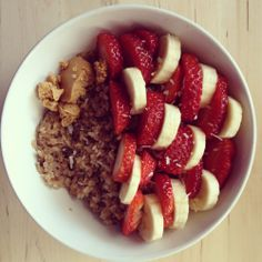 Gluten free oatmeal with peanut butter strawberries and banana