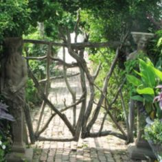 figurative gateposts with branch gate...love the way the two pieces fit together.