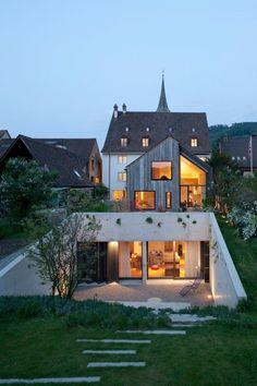 La conception de ce projet réutilisation adaptative est né d'abord d'un concours de design lancé par la Ville de Muttenz / Bâle - Architecte : Oppenheim Architecture