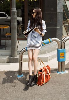 21e4f408aebd3 I love this outfit. Chambray over a striped bodycon dress with chunky  boots. Korean