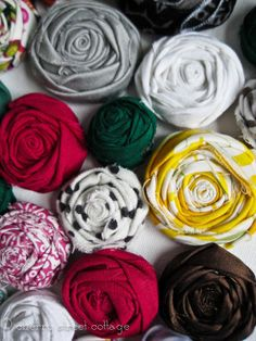 Fabric Rose Flower.  Beautiful and simple.  These can be put to use in many different ways.  I now know what i'll be using all my vintage fabric scraps for.  Thanks Grandma.