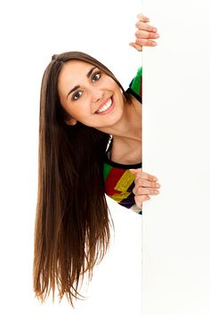 Young smiling woman holding blank billboard
