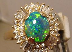 I think I have the prettiest birthstone.. just sayin :) .Opal ring.