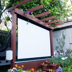 Watch movies in your garden with this outdoor theater that doubles as an arbor.