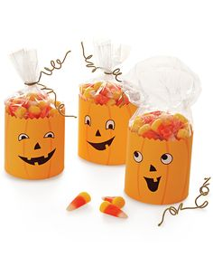 "These goofy jack-o'-lanterns make quick, sweet party favors.  Print the pumpkin clip art on card stock and cut out. Trim top edge with pinking shears and use invisible tape to secure it around a little bag of candy corn. Curl cloth-covered floral wire around a pencil to create a ""stem,"" and use to close bag."