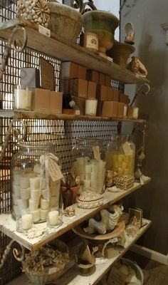 Beautiful vintage vibe display that could be used to sell candles or soaps at a craft fair.