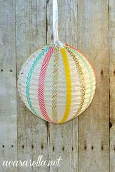 Washi tape paper lanterns from 'A Casarella' make great party decorations or embellishments for a baby's room.