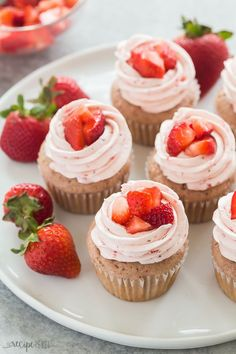 These Strawberry Cupcakes are made with real strawberries -- no Jello powder or cake mix here! They are topped with a creamy Strawberry Frosting and are perfect for any summer birthday, party or baby shower with their pretty pink hue. Recipe includes a full STEP BY STEP recipe VIDEO.