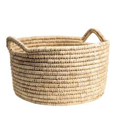 Natural. Short, wide storage basket in braided straw with two handles at top. Height 10 1/4 in., diameter 17 3/4 in.