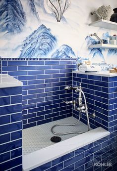 A blue tile shower, in this case a doggy shower, adds a bold pop of color to a bathroom or laundry room. Explore more home design trends and décor inspiration inside the San Francisco Decorator Showcase where art and home design take shape.