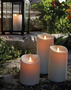 Luminara Outdoor Candle - Ivory x 7 - With Timer - Remote Ready See the video below of this amazing candle featuring Disney technology!This LED flickering flameless Luminara pillar candle is Outdoor Candles, Outdoor Gifts, Candle Lanterns, Outdoor Lighting, Candle Lighting, Lantern Centerpieces, Best Candles, White Candles, Pillar Candles