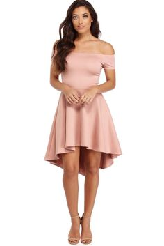 "<p>Off the shoulder dresses are all the rage this season! Show off your amazing fashion sense with this dress that features an elastic off the shoulder neckline, short sleeves, a slim fitting bodice and a super cute skater skirt with a hi low hem.</p>  <p><em>Model is 5'7 with a 34"" bust, 24"" waist and 36"" hips. She is wearing a size small.</em></p>"