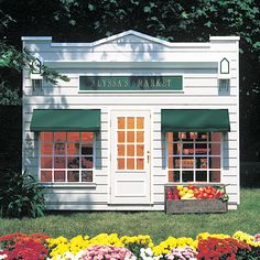 Cute.  I'm sure there's a way to recreate something similar on a more practical budget.   Neighborhood Market Playhouse from PoshTots