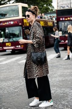 leopard coat, cropped black trousers, trainers