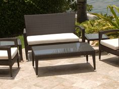 strict outdoor rattan coffee table with glass top