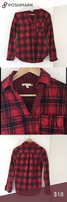 🆕 Plaid Flannel Button Up Top This super cute flannel top features a plaid design and is red and black with a touch of orange on the thinner lines.  The collar features a smaller checkered red and black design and has no buttons on it, which gives it a more feminine feel.  NWOT Tops Button Down Shirts