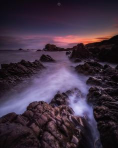 Morning Moment - A long exposure, landscape image of waves swirling around the rocks on the shore of Findochty in Morayshire, Scotland, at sunrise.
