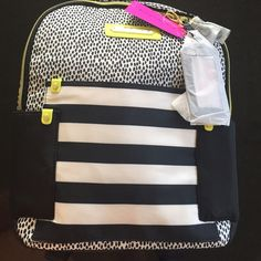 Betsey Johnson backpack Betsey Johnson backpack, multi pocket, zip around.  Pretty black spots on white background with striped pocket in front & two black pockets on each side. Citron accents with gold hardware. Luggage tag attached with a gold clip, still wrapped in tissue.  Roomy interior with a zipped pocket.  New with tag attached. Betsey Johnson Bags Backpacks
