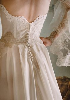 Claire Pettibone Marie strapless wedding dress with lace embroidered bodice, silk buttons down the back, and flowing cotton skirt and long train. Elaborate lace and tulle sheer long sleeves. Wedding Dress Backs, Best Wedding Dresses, Wedding Gowns, Embroidered Wedding Dresses, Bridal Gown, Modest Wedding, Tulle Wedding, Embroidered Lace, Wedding Hair