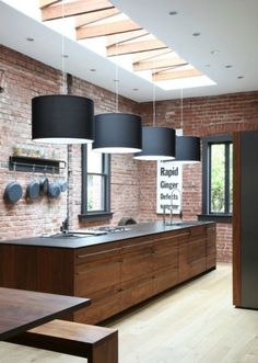 Elegant Open Kitchen with Natural Interior Lighting Systems: Bold Natural Touch For Lovell Kitchen Design Combining Exposed Brick Wall With Wooden Rectangular Island With Four Modern Black Pendant Lamps House Design, Rustic Modern Kitchen, Interior, Modern Kitchen Pendants, Contemporary Kitchen, Home Decor, House Interior, Modern Kitchen Design, Kitchen Design