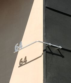 The play of shadows on the iconic shape, as well as on the shapes of the house numbers, is a Levy trademark.   Photo by Caren Alpert.