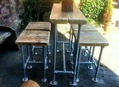 Industrial Style Reclaimed Scaffold Breakfast Bar and Four Stools. Love the industrial look of this set!