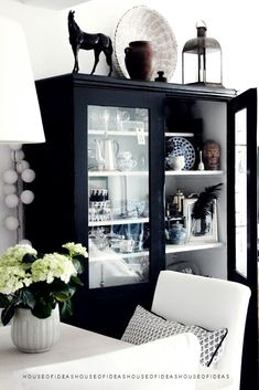 HOUSE of IDEAS Black cabinet - I like the idea of a treasure cabinet, for all your small findings and memories