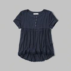 supersoft and drapey with subtle stretch, henley neckline and lace trim at hem, imported<br><Br>95% viscose / 5% elastane