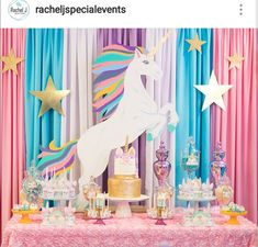 Magical unicorn themed birthday party dessert table in the court