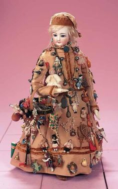 Don't have any information on this antique toy peddler doll, but isn't she magnificent?