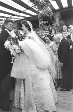 http://en.wikipedia.org/wiki/Jacqueline_Kennedy_Onassis Future US President John F Kennedy (1917 - 1963) and Jacqueline Kennedy (1929 - 1994) (in a Battenburg wedding dress) take the first dance at their wedding reception, Newport, Rhode Island, September 12, 1953. (Photo by Lisa Larsen/Time & Life Pictures/Getty Images.  http://en.wikipedia.org/wiki/Wedding_dress_of_Jacqueline_Bouvier