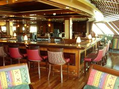 Congo Bar (Deck 6): The clue is in the name here. It's located at the aft of the ship and its floor-to-ceiling windows look out over the ocean. Passengers come to read their books here in the daytime, while it's the place to watch karaoke competitions and live music in the evenings. Congo Bars, Eastern Caribbean Cruises, Jewel Of The Seas, Cruise Port, Floor To Ceiling Windows, Barbados, Flooring, Karaoke, Live Music