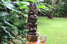 Makana Hut's own LOVE Tiki. Natural or Stained Finish. 26 inch Love Tiki totem is carved out of premium Acacia wood. Perfect Tiki for any collector. Tiki Totem, Bar Areas, Acacia Wood, Hawaiian, Hand Carved, Garden Sculpture, Carving, Outdoor Decor, Green
