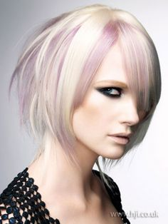 Platinum choppy bob with lavender streaks. I would LOVE to do this to my hair.