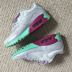 Nike air max 90s super clean NIKE AirMax 90s. Worn a few times. Size 6.5 women's. Rare colors: grey, raspberry, and mint. Authentic. Minor wear and slight creasing. One shoe ha a scuff on the upper toe area (see photos) they are very clean , the inside of shoe and insoles are like new, & the bottom of soles are not worn down at all. air bubble is clear w/no yellowing/foggy discoloration. retail $189 thru NikeID. Smoke free home. Same or next day shipping. Please don't low ball or ask…