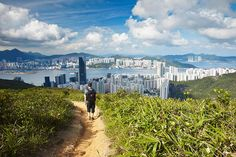 Man on a hiking trail heading toward Hong Kong. Image by Ian Trower / AWL Images / Getty Images. http://www.lonelyplanet.com/asia/travel-tips-and-articles/the-dragons-back-and-beyond-the-best-hikes-in-hong-kong#ixzz350GWJ52O