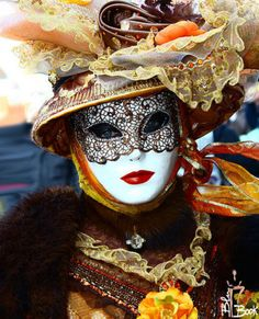 Venetian Carnival Mask....interesting, a mask painted on her mask.