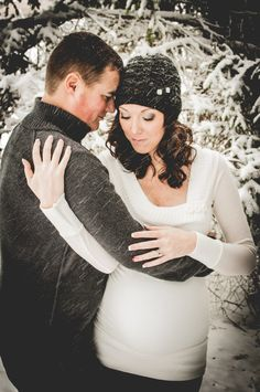 Winter maternity couple photography snow snowy photo model baby magical pregnancy family brunette sweater love www.facebook.com/photosbycarriebower