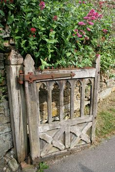 Old antique gate adds charm to this garden.