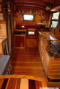 The use of inlaid wood of varying types along with a high gloss finish gives the feel of vintage luxury to this unique motor home. The step up bed in the back is calling...