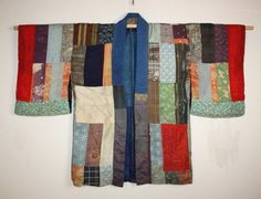 Edo yosegire han-jyuban boro Tattered textile. This is yosegire silk Patchwork han-jyuban boro Tattered textile of the Edo era(1800-1868). It can enjoy both sides. It is done patchwork in shikon-dye-shibori and beni-itajime-dye and katazome and Stripe