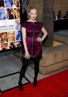 Amanda Seyfried Leather Clutch - Amanda paired her zip-up dress with a wrinkled leather clutch which was a little hard to see when nest to her black tights.