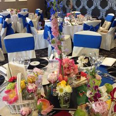 The Garden Room looking fab with royal blue bows on the chairs and stunning floral arrangements from Flower Design