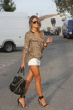 Leopard print blouse, white capris or pants.