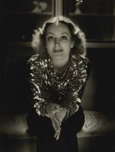 Joan Crawford, 1934, in a gown by Adrian, photo by George Hurrell via lvintagechampagnefever