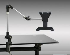 """Armbot iPad Tablet Mount ($79.95) Optional mounting brackets - one for desk mount and one for wall mounting  Three sectioned modular arm can be used with one, two or all three arm sections  Attaches to table or desk tops, night stands, headboards, end tables and coffee tables  37.4"""" long at full extensions with all three arm sections  Plastic holder accommodates iPad as well as tablets from 5-34"""" wide up to 10-1/8"""" tall"""