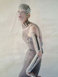 Versace dress, Robert Lee Morris necklace and cuffs, sterling silver glove by Shaun Leane for Daphne Guinness